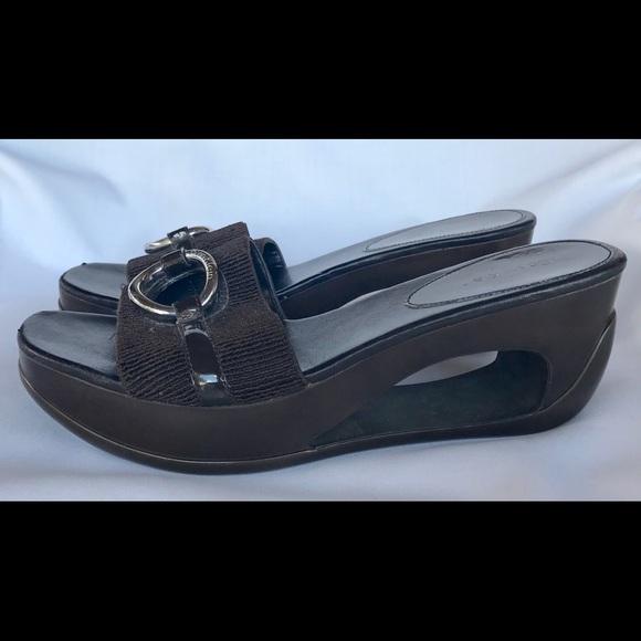 fd345ed747f Calvin Klein Shoes - Calvin Klein Brown Wedge Cut Out Heel Sandal 8.5M